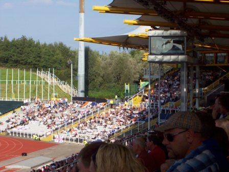 The main stand with away fans in the two tiered structure in the background behind the 100m finish line and to the left overspill for the impressive Luton following.