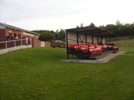 Clubhouse and behind-the-goal stand