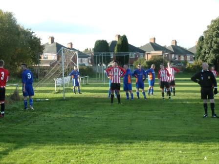 Players look for the ball while waiting for the corner